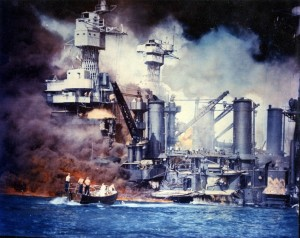 A U.S. Navy motor launch pulls sailors from the water in this colorized image of the stricken battleship USS West Virginia. Hit by several Japanese torpedoes, the West Virginia quickly settled to the bottom of Pearl Harbor in an upright orientation due to quick counterflooding to control the list from the torpedo strikes.