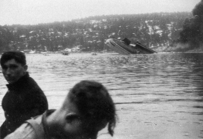 Moments before its final plunge, the battered hulk of the Blücher is photographed from a German destroyer waiting nearby to pick up survivors.