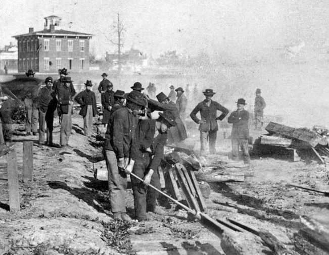 """The day before leaving Atlanta, these Union troops left a going away present for hard-pressed Southerners—another bit of twisted railroad tracks known as """"Sherman bowties."""""""