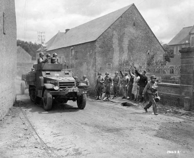 Ralph Puhalovich was a member of a half-track crew such as this one, pulling an antitank gun through a French village a week after the invasion.