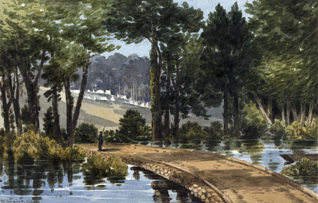 A lone Union sentry guards a temporary wooden bridge built by industrious engineers over the Chickahominy River. Army tents are in the distance.