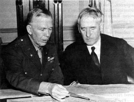 George C. Marshall (right) in discussion with Secretary of War Henry Stimson.