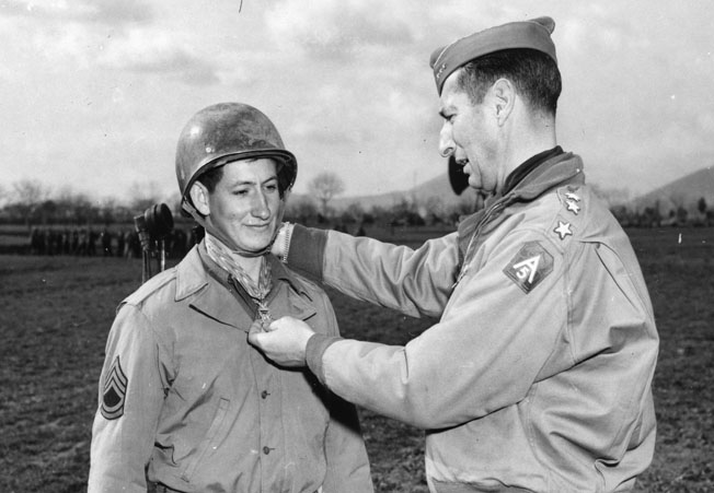 """""""Commando"""" Charles E. Kelly receives the Medal of Honor from Lieutenant General Mark Clark, commander of the U.S. Fifth Army in Italy."""
