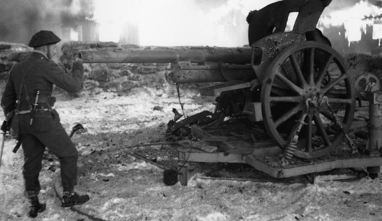 Churchill inspects the wreckage of a German field gun following action against elements of the Wehrmacht in France.