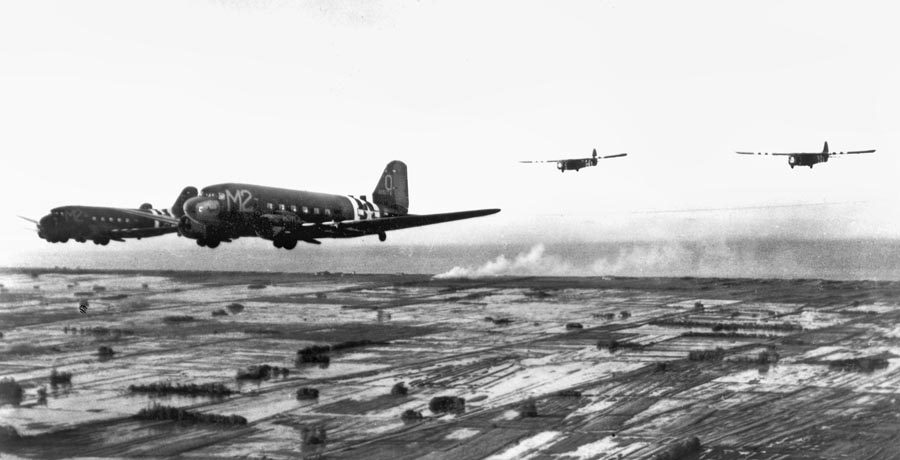 C-47s towing gliders during Operation Overlord.