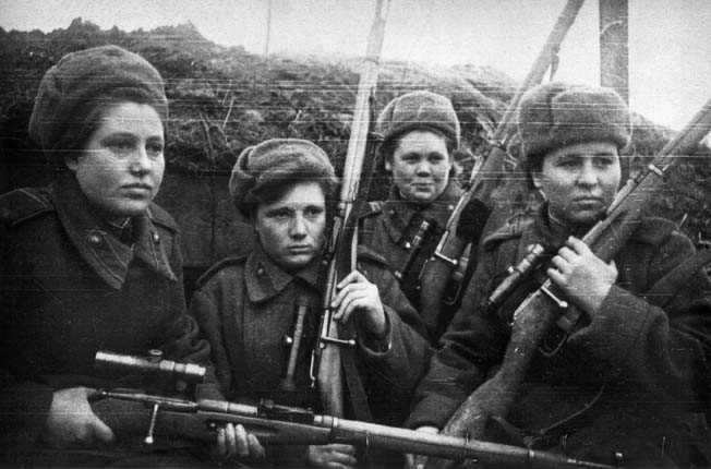 These female Soviet snipers posed for the photographer with grim determination. Allerberger took out a group of female snipers firing at German soldiers from trees.