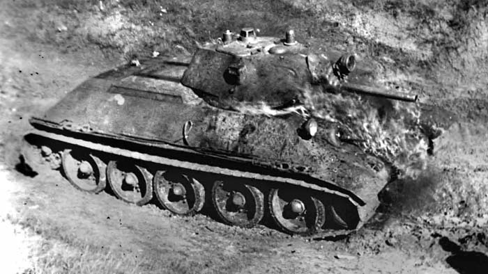 "A T-34 prototype being tested against ""Molotov cocktails"" (improvised firebombs) in March 1940. Over 64,000 T-34s were built during the war."