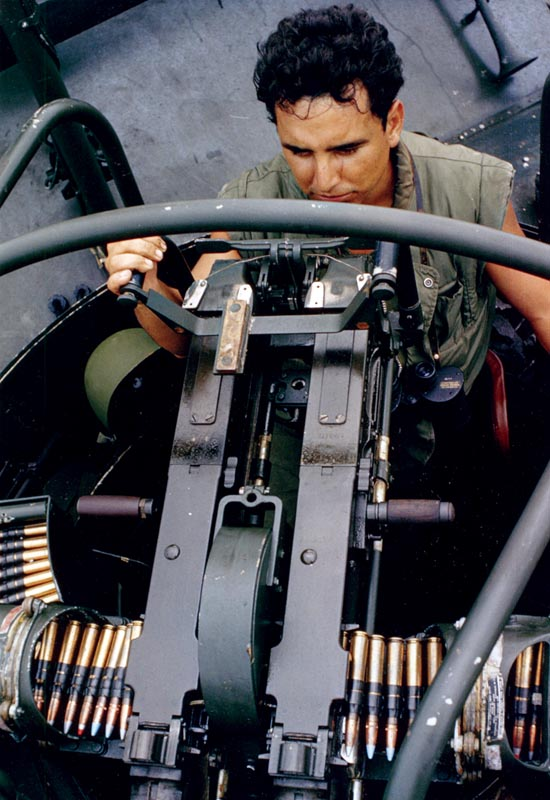 A sailor mans his twin air-cooled, belt-fed .50 caliber machine gun mount while patrolling for Viet Cong activity. The weapon was positioned in an armored forward turret.