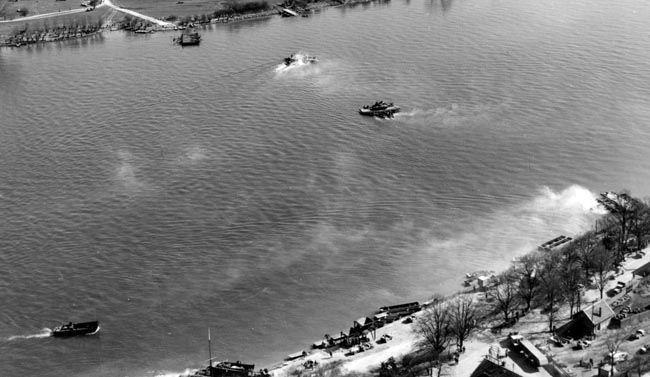 Tanks of Patton's Third Army are ferried across the Rhine by LCMs at Oppenheim on March 22, 1945. Had it not been for the participation of the U.S. Navy and Coast Guard, the Allied crossing of the Rhine would not have been accomplished so swiftly.
