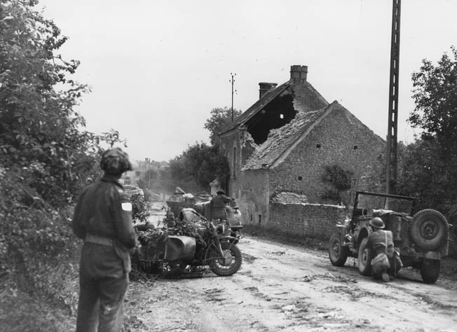 "A Canadian patrol stops to inspect a German staff car and motorcycle in a village ""somewhere in Normandy."""