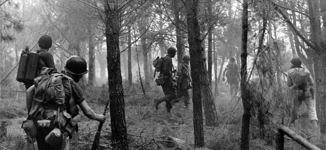Following a virtually uncontested landing on the southern coast of France on August 15, 1944, U.S. soldiers advance inland through a heavily  wooded area. The landings in southern France stretched an already thinning Axis military capability in Western Europe, only a few weeks after the Allied D-Day landings in Normandy.