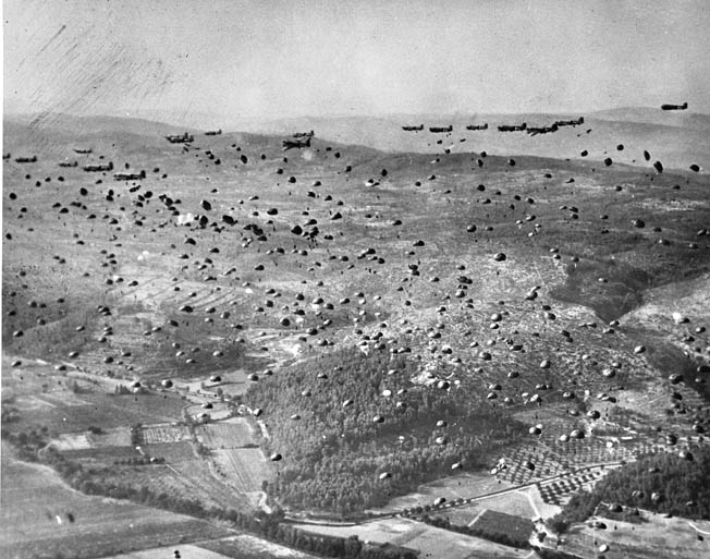 The skies are filled with silk as transport planes drop hundreds of 551st Parachute Infantry Battalion paratroopers near Le Muy, 10 miles inland.