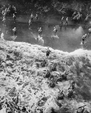With almost no beach separating the water from the jungle at Cape Gloucester on the island of New Britain, U.S. Marines wade ashore and directly into the island's dense vegetation. Company K's Wilheit and Terzi, now captains, would both be killed here in December 1943.