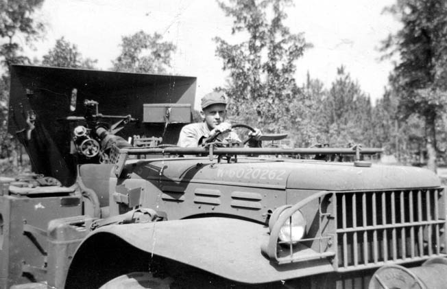 Private Bromberg drives a weapons carrier pulling an artillery piece at Fort Knox, where he learned to double clutch a tank to slow it down. After the war his father did not appreciate this skill when applied to the family car.