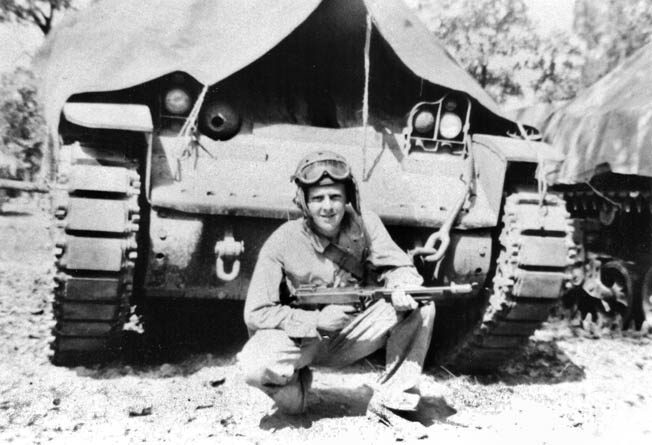 With a Thompson machine gun in hand, Bromberg crouches in front of an M3 Stewart tank. The Stewart proved obsolete by the time the U.S. Army landed in Morocco at the end of 1942.