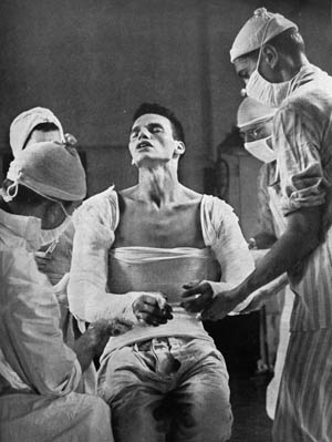 Morse caught Lott grimacing in pain as Army surgeons applied plaster casts to his injured body and arms back in the States.