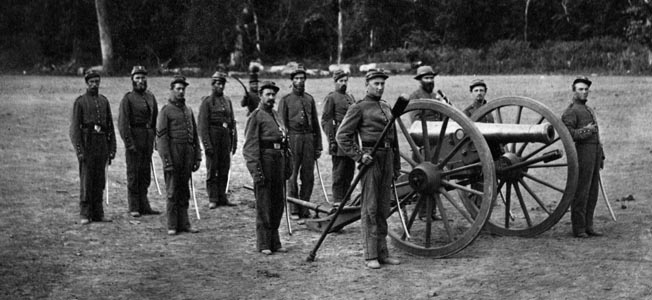 An alert crew from the 1st Illinois Artillery poses beside their gun. The unit's Battery K took along six light-caliber Woodruff guns on the Grierson raid.