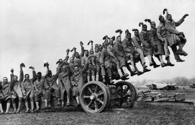 "Members of the 349th Field Artillery Battalion pose for a photo during pre-war training at Fort Sill, Oklahoma. The U.S. Army was dubious about the fighting qualities of ""colored"" units and many African American soldiers never expected to see combat."