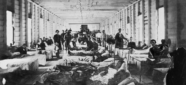 Wounded Union soldiers convalesce near Alexandria, Virginia, in July 1864. The grinding Wilderness campaign that spring and summer filled the hospitals to bursting.