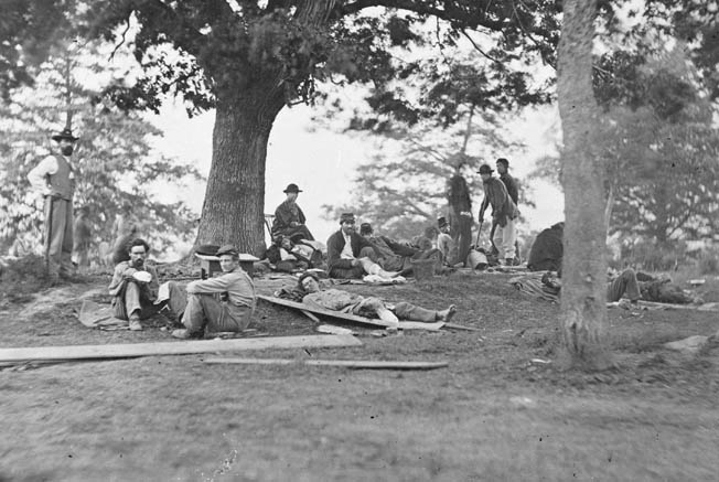 Wounded soldiers on the grass outside a field at Fredericksburg, Virginia. Many of the wounded would end up in hospitals in Washington, where they either recuperated or died.