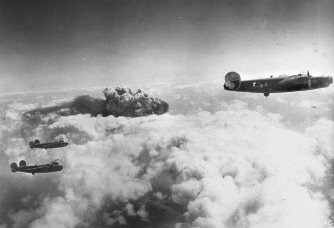 A large cloud of dark smoke in the distance indicates that the Fifteenth Air Force's attack on the German-controlled oil-production facilities at Ploesti, Romania, May 1944, is successful. Ploesti was bombed 22 times by the Fifteenth Air Force.