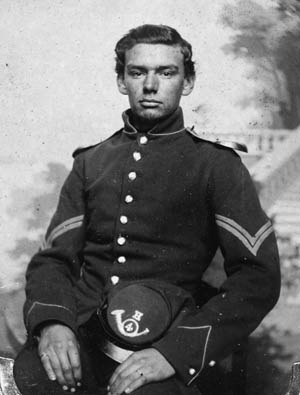 This corporal holds his Model 1858 Forage Cap, with a Company H insignia.