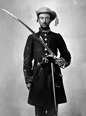 A well-turned-out Mississippi cavalryman, with a tasseled hat and an unsheathed saber, poses