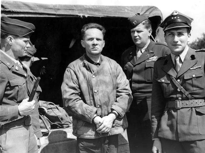 Rudolph Hoess, the longest serving commandant of the death camp at Auschwitz, arrives to testify during the post-World War II war crimes trials in Nuremberg. After his testimony, Hoess was turned over to Polish authorities, convicted of war crimes during a separate trial, and hanged in Warsaw.