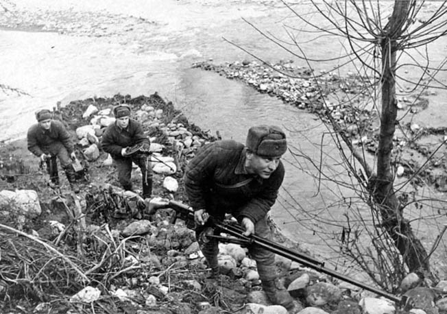 A Soviet antitank rifle team, which includes a light machine gun, advances cautiously during combat in the Caucasus Mountains in 1942. Soviet antitank teams often let German tanks rumble past their position so that they could target the thinner armor in the rear.