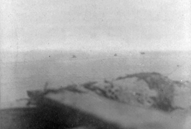 Appearing as gray specks in the distance, Federal ironclads Weehawken, Montauk, and Passaic, were snapped from the fort's parapet.