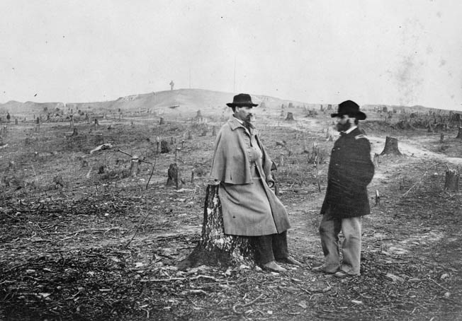 Orlando M. Poe, left, confers after the Battle of Knoxville with fellow engineer Orville Babcock amid the tree stumps in front of Fort Sanders' northwest bastion.
