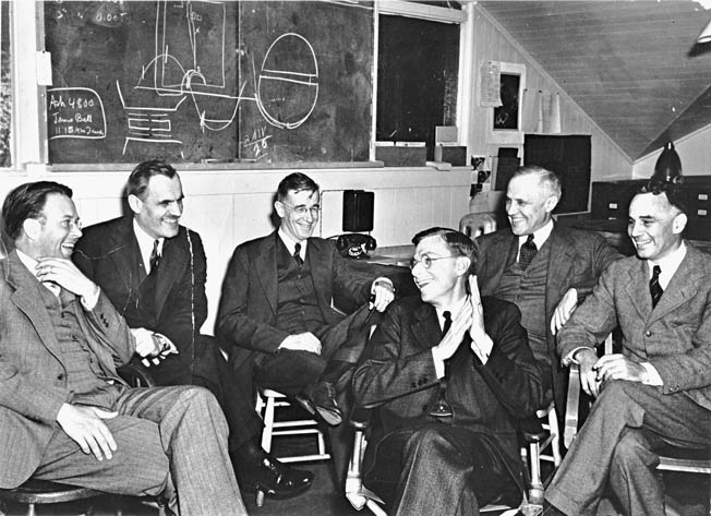 Manhattan Project scientists discuss the giant cyclotron at Berkley in April 1940 (left to right): Ernest O. Lawrence, Arthur H. Compton, Vannevar Bush, James B. Conant, Karl T. Compton, and Alfred Loomis.