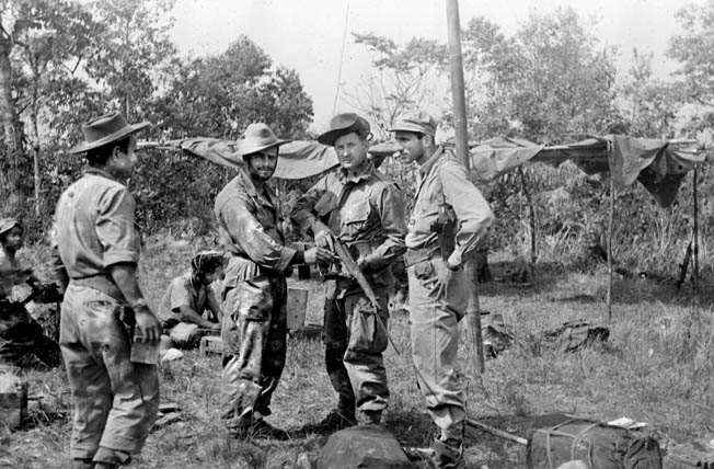 Operatives of OSS Detachment 101 pause for a photograph somewhere in the Burmese jungle. This photo was taken in 1944, and by that time Detachment 101 was executing covert missions that took a heavy toll in Japanese lives and war matériel.