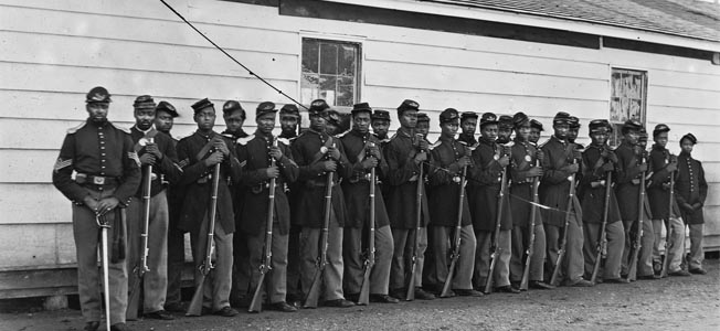 A well turned out Company E, 4th U.S. Colored Troops, musters in for a group photograph following its combat at Chaffin's Farm.