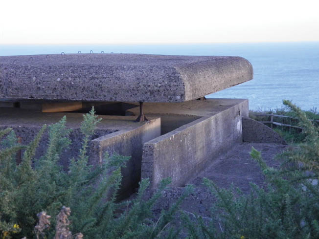 The Type M262 fire-control bunker at Longues-sur-Mer looks out toward the English Channel, which was filled with more than 7,000 Allied warships on June 6, 1944. Scenes for the 1962 film, The Longest Day, were shot here.