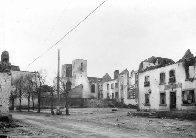 The devastated center of Hosingen with the Hotel Schmitz (right) where K Company had its command post during the battle.