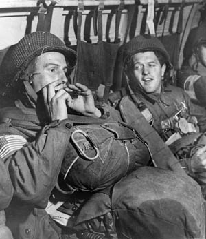 A 507th PIR soldier plays his harmonica to ease prejump jitters. Operation Varsity was the only time all elements of the 17th Airborne Division made a combat jump together.