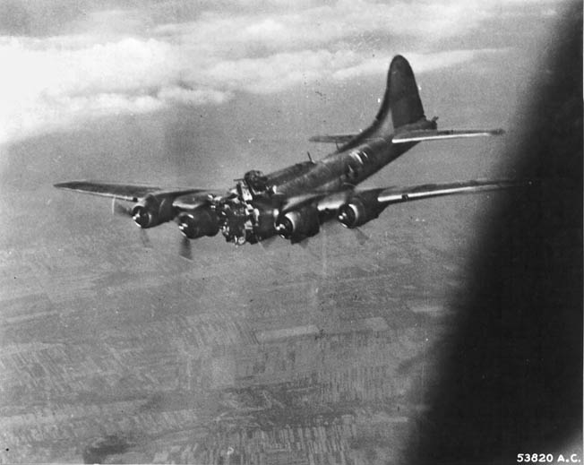 This B-17, nicknamed Mizpah, took a direct hit from German flak during a raid in July 1944. The enemy shell smashed the bomber's nose section and killed two crewmen instantly. The pilot of the stricken bomber was able to hold the plane level long enough for the remaining crewmen to bail out. The plane crashed in Hungary and the survivors were captured.