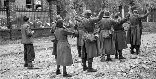 German soldiers surrender to American troops on October 19, 1944, two days prior to the official end of hostilities in Aachen. When the Germans formally surrendered, the Americans rounded up 1,600 exhausted and dazed enemy personnel.
