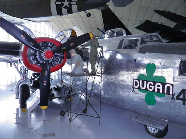 """Mannequins """"work"""" on the engine of the museum's B-24 bomber, Dugan."""