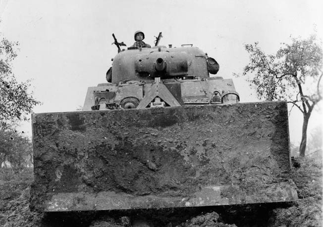 The bulldozer tank proved bulky and slow. Bromberg felt these tanks would only attract enemy fire in Normandy's hedgerows. They were eventually replaced by Rhino tanks.