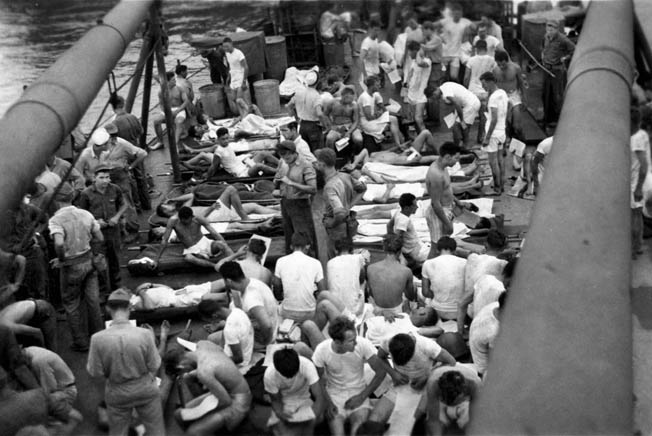 Survivors of the Indianapolis lie on the deck of the high-speed transport USS Bassett after their rescue from the desolation of the Pacific Ocean. Rescue efforts got underway some time after the actual sinking, and many crewmen were lost to wounds, exposure, delirium, and marauding tiger sharks.