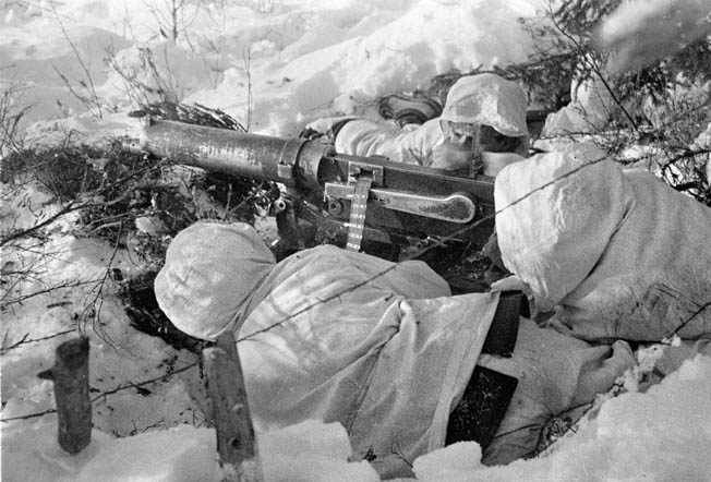 Finnish troops man a machine-gun position against oncoming Soviet troops. The Finns were outgunned by superior Soviet armor and air power; however, Finnish tactics made the most the assets available.