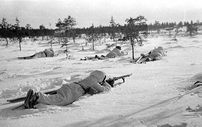 During an attack along the River Kollaanjoki on December 17, 1939, a Red Army tank advances slowly across a snow-covered hillside. Finnish troops often lay in ambush, taking advancing Soviet columns by surprise, inflicting casualties, and then melting into the deep forest.