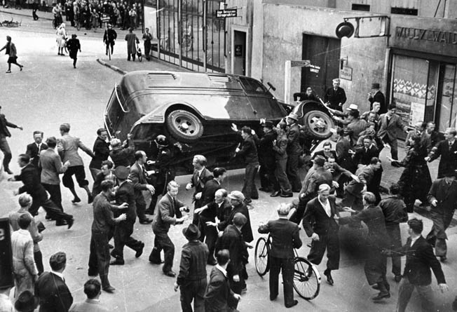 Anti-German anger surfaces in August 1943. Citizens of Odense overturn a police van carrying Danish political prisoners as a protest against German rule and official Danish government collaboration.