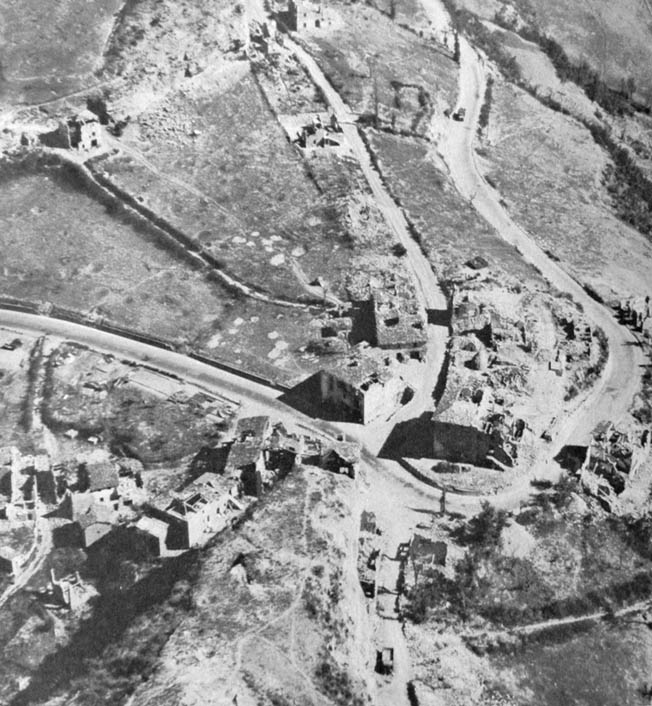 Livergnano, strategically situated on Florence-Bologna Highway 65, was reduced to ruins by heavy fighting.