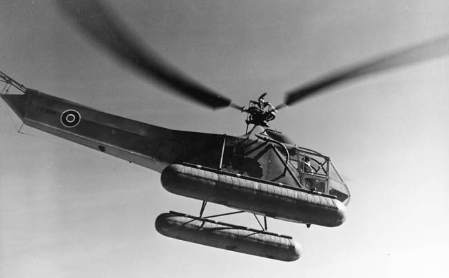 Commander Frank Erickson pilots a Sikorsky HNS-1 helicopter with British Royal Air Force markings in early January 1944. This photo was taken around the time that Erickson delivered lifesaving blood plasma to survivors of the destroyer USS Turner.