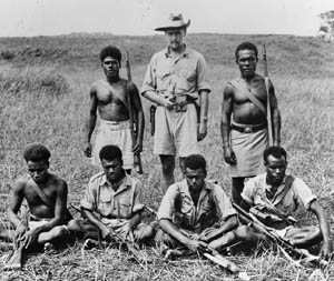 Guadalcanal District Officer Martin Clemens photographed with members of the island's Defense Force Scouts.
