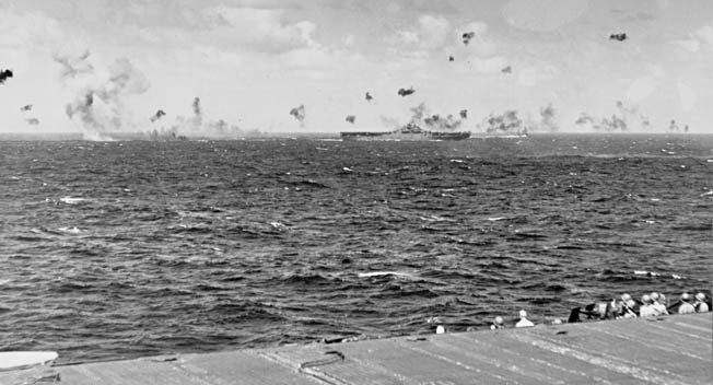 Antiaircraft shells explode as Japanese planes attack the Yorktown during an American raid on Kwajalein Atoll in the Marshall Islands, December 4, 1943. The Marshalls would be invaded by U.S. forces 11 months later.