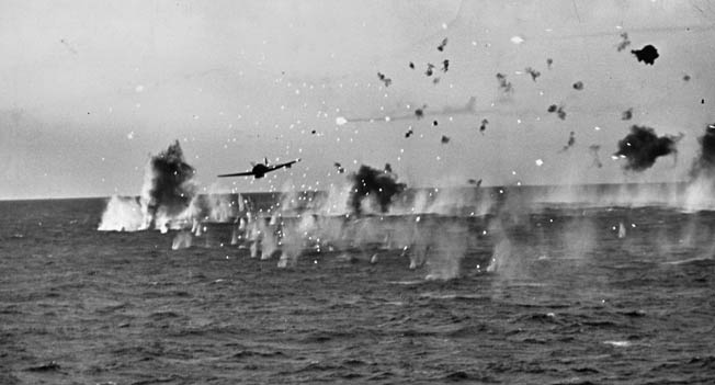 "Trying to attack the Yorktown near Truk Island, a Japanese ""Jill"" torpedo bomber flies through a storm of antiaircraft fire, April 29, 1944."